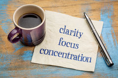 Clarity, focus and concentration. Inspirational words - handwriting on a napkin with a cup of espresso coffee Stock Photo