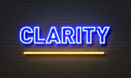 Clarity neon sign on brick wall background. Stock Images