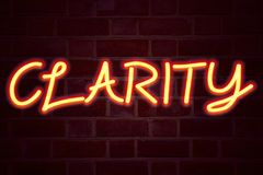 Clarity neon sign on brick wall background. Fluorescent Neon tube Sign on brickwork Business concept for Clarity Message 3D render Royalty Free Stock Images