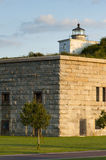 Clark's Point Lighthouse Sits on Fort Taber on a Warm Summer Evening Royalty Free Stock Images