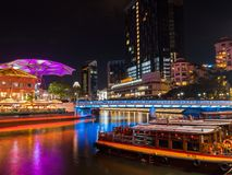 Clarke Quay at Night with Boat View in Riverside Singapore, royalty free stock images