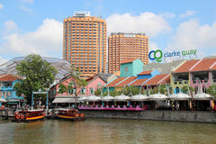 Clarke Quay - Singapore. Clarke Quay is a historical riverside quay in Singapore. At the height of its prosperity, dozens of bumboats jostled for mooring space Stock Photos