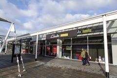 Clarks Shoe Shop in a McArthur Glen Retail Outlet. Bridgend, Wales, UK: January 14, 2017: Shoppers pass a Clarks Shoe Shop Outlet. Clarks is an international Stock Photos