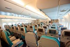Clase de economía de Singapore Airlines Imagenes de archivo