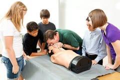 Clase de la salud de la escuela de Hight - CPR Imagenes de archivo