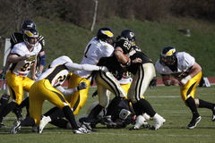 Clash of defense and offence in american football Stock Images