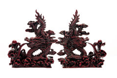Clash of the Dragons. Two Marble Stone Dragon Book End Decoratives on White Stock Photography
