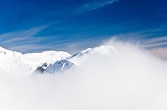 Fog at the top of the mountain on a winter sunny morning Royalty Free Stock Photos
