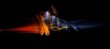 Clashing energy smoke waves Stock Image