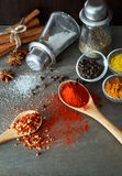 Clashing Spices From Spoon Stock Photo
