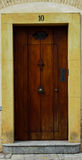Clasic Spanish Door. Sample on brown bricks wall Royalty Free Stock Photo