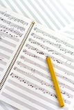 Clasic wooden pencil with written music Stock Image