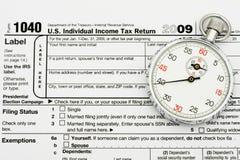 Clasifíe sus impuestos el tiempo Foto de archivo