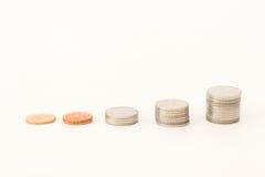 Clasifique las monedas que ascienden fotos de archivo