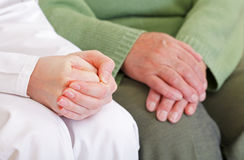 Anxious and relaxed hands. Clasped anxious young and elderly relaxed hands Stock Photos