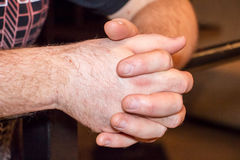 Clasped hands of men Royalty Free Stock Photography