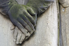 Clasped hands. Statue of an angel at old cemetery - circa 1860, Krasna Lipa, Czech republic, Europe Stock Image