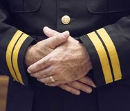 Clasped Hands in Uniform Stock Photo
