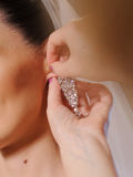 Clasping Earring Royalty Free Stock Photos