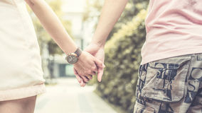 Clasping hand. Close-up of lovers' hands holding each other Stock Image