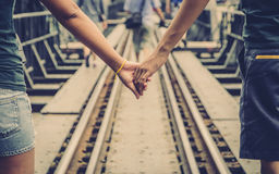 Clasping hand on the rail Stock Image