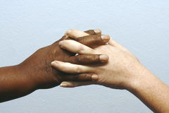 Clasping hands Royalty Free Stock Image