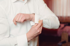 Clasping Link on Sleeve Royalty Free Stock Images