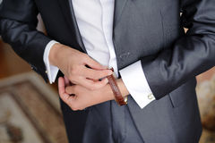Clasping Watch Belt Stock Image