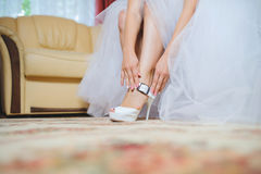 Clasping Wedding Shoe Royalty Free Stock Image