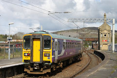 Class 153 super sprinter diesel leaving Carnforth Royalty Free Stock Images