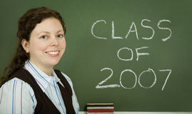 Class of 2007. Young teacher in front of a chalkboard stock photos