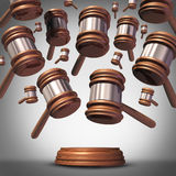 Class Action Lawsuit. Concept as a plaintiff group represented by many judge mallets or gavel icons coming down as a symbol for social litigation or organized Royalty Free Stock Photography