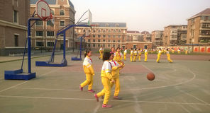 After class activity. Pupils of nanjiang primary school Tianjin are playing basketball after class  Tianjin China photoed on February 19th 2014 Stock Photos