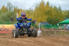 Class ATV-JUNIORS. SERPUKHOV, RUSSIA - OCTOBER 7, 2017: Nikolaev Maksim 13,  Class ATV-JUNIORS, in the 4 stage  MX series, the Red Wings Cup 2017 super country Royalty Free Stock Photo