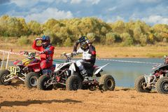 Class ATV. SERPUKHOV, RUSSIA - OCTOBER 7, 2017:  Before the race, Class ATV, in the 4 stage  MX series, the Red Wings Cup 2017 super country-cross, Moto-track Royalty Free Stock Photo