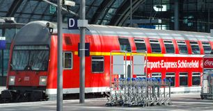 Airport-express Schonefeld Airport train in Berlin Central rail terminal. Class 143 DB electric double deck push-pull set to Berlin Schonefeld Airport in upper Stock Images