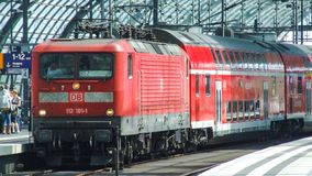 Class 143 DB electric locomotive in push-pull set configuration in Berlin Central terminal. Class 143 DB electric locomotive in push-pull set configuration in Royalty Free Stock Photography