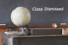 Class Dismissed Message on Old Chalkboard Royalty Free Stock Photography