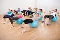 Class of diverse people doing pilates Royalty Free Stock Photos