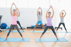 Class doing pilate exercises in fitness studio Royalty Free Stock Image