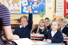 Class Of Elementary School Pupils Answering Question Stock Image