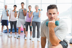 Class exercising with dumbbells in gym Royalty Free Stock Images