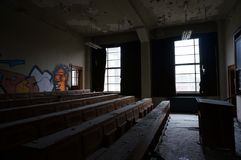 The class had been dismissed. This classroom had been dismissed for many years now, a forgotten room at an forgotten building Stock Photos