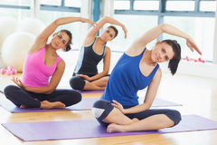 Class and instructor doing stretching pilate exercises Stock Photo