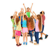 Class leader girl raised hands in circle of mates stock photography