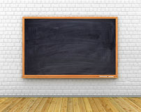 Class room with black chalkboard on the wall, wooden floor. Stock Images