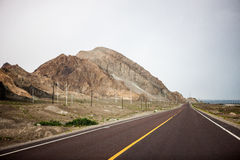 Class scenery: the barren hills and highways Stock Images