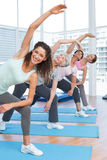 Class stretching hands at yoga class Royalty Free Stock Image