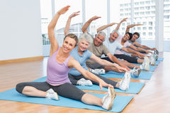 Class stretching hands at yoga class Stock Image