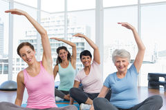 Class stretching hands at yoga class Stock Photography